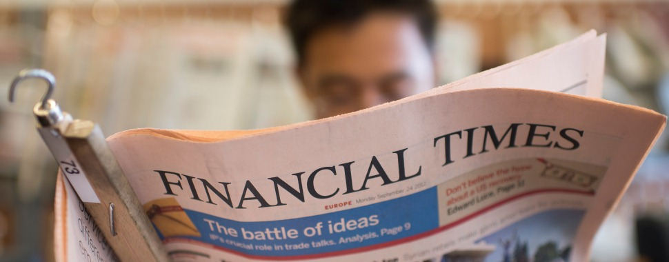 "A student reads the ""Financial Times"""